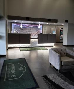 The lobby or reception area at Wingate by Wyndham Greenville Airport