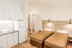 Ліжко або ліжка в номері Smart Apart