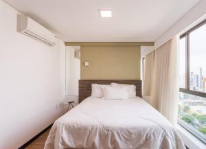 A bed or beds in a room at Hotel em Boa Viagem 20 andar