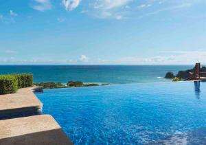 The swimming pool at or near Punta Islita, Autograph Collection