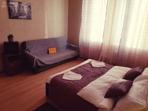 A bed or beds in a room at InnDays Юбилейная улица 13а
