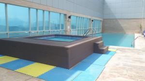 The swimming pool at or near Royal M Hotel Fujairah Mall