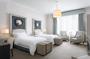 A bed or beds in a room at Hotel Bristol, A Luxury Collection Hotel, Warsaw