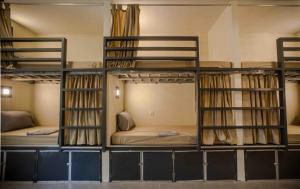 A bunk bed or bunk beds in a room at Nest Beach Club