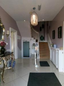 The lobby or reception area at Alcombe House Hotel