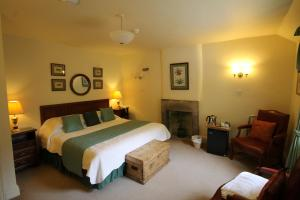 A bed or beds in a room at Biggin Hall Country House Hotel