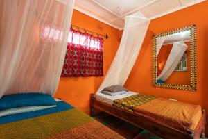 A bed or beds in a room at Victoria Falls Backpackers Zambia