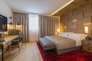 A bed or beds in a room at Canopy by Hilton Zagreb City Centre