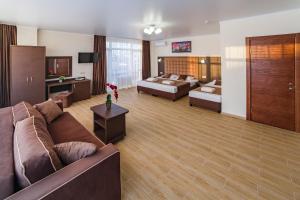 A seating area at Leonsia Family Hotel