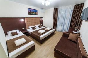 A bed or beds in a room at Leonsia Family Hotel