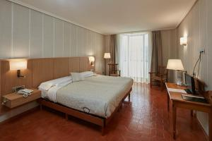 Cama o camas de una habitación en HOSTAL DOÑA JUANA