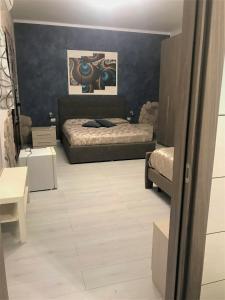 Letto o letti in una camera di B&B Etna House