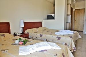 Ένα ή περισσότερα κρεβάτια σε δωμάτιο στο Evia Studios