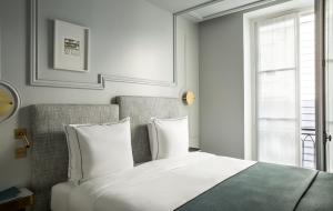 A bed or beds in a room at Maison Armance - Esprit de France