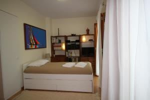 A bed or beds in a room at Dream House Óbidos