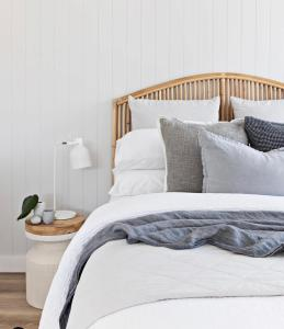 A bed or beds in a room at Swell Kiama
