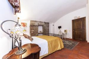 Ein Bett oder Betten in einem Zimmer der Unterkunft Rifugio degli Artisti
