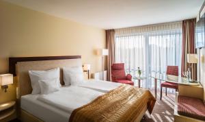 Ein Bett oder Betten in einem Zimmer der Unterkunft Best Western Plus Residenzhotel Lüneburg