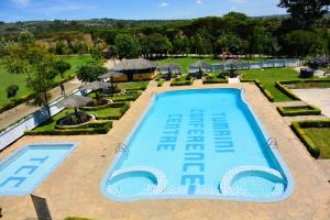 A view of the pool at Tumaini Cottages and Conference Centre or nearby