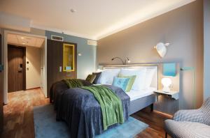 Säng eller sängar i ett rum på Clarion Hotel The Hub