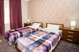Кровать или кровати в номере AZPETROL HOTEL BALAKEN