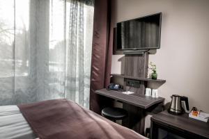 En tv och/eller ett underhållningssystem på Hotel Tegnerlunden