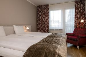 Säng eller sängar i ett rum på Hotel Tegnerlunden