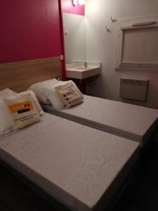 Un ou plusieurs lits dans un hébergement de l'établissement hotelF1 Genève Saint Julien en Genevois