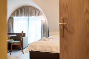 Ein Bett oder Betten in einem Zimmer der Unterkunft Aparthaus