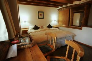 Una cama o camas en una habitación de Patagonia Villa Lodge