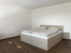 Postel nebo postele na pokoji v ubytování Hotel Slavia Holešov