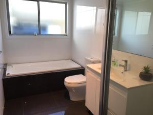 A bathroom at Deep Blue, 5 Kinchela Street,