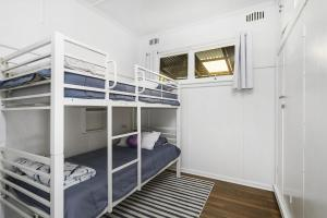 A bunk bed or bunk beds in a room at Whitecaps, 26 East Street