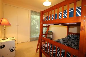 A bunk bed or bunk beds in a room at The Deck, 16 Noogah Terrace,