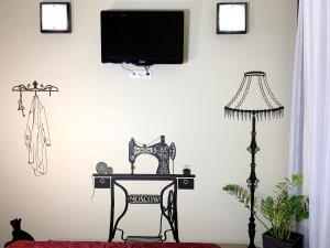 Телевизор и/или развлекательный центр в Бутик-отель Сретенский Двор