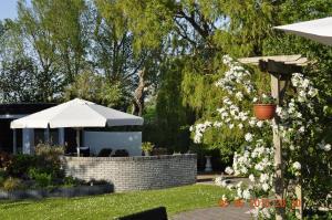 Een tuin van CountryHouse de Vlasschure