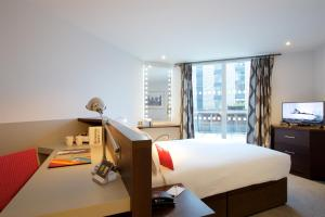 A bed or beds in a room at Bermondsey Square Hotel - A Bespoke Hotel