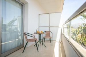 A balcony or terrace at Hotel Sun Palace Albir & Spa