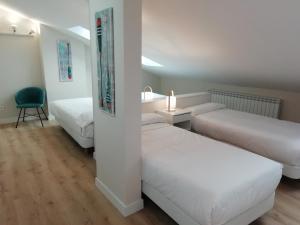 Cama o camas de una habitación en Pensión Txiki Polit