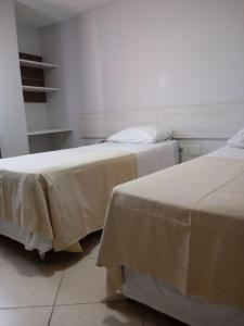 A bed or beds in a room at Akropolis Home