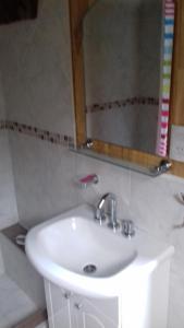 A bathroom at Cabañas Villa Centauro