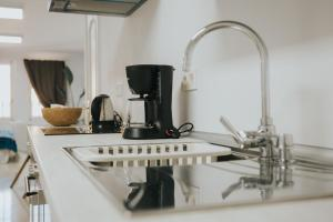 A kitchen or kitchenette at Home Bassou