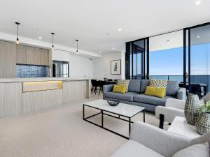 A seating area at BRAND NEW Qube Broabeach Luxury 2 Bedroom