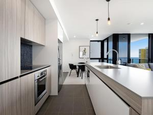 A kitchen or kitchenette at BRAND NEW Qube Broabeach Luxury 2 Bedroom