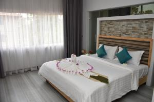 A bed or beds in a room at Everland Boutique Hotel