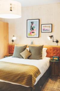 Ein Bett oder Betten in einem Zimmer der Unterkunft The Royal Foresters