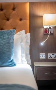 Letto o letti in una camera di Grand Canal Hotel