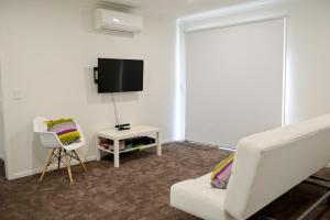 A television and/or entertainment center at 7 Gilmore St, Smiths Beach
