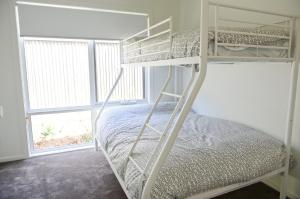 A bunk bed or bunk beds in a room at 7 Gilmore St, Smiths Beach