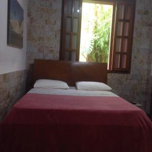 A bed or beds in a room at Sefiroh Hostel